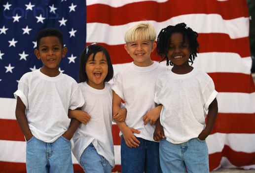 USA --- Children in Front of American Flag --- Image by © Jerry Tobias/CORBIS